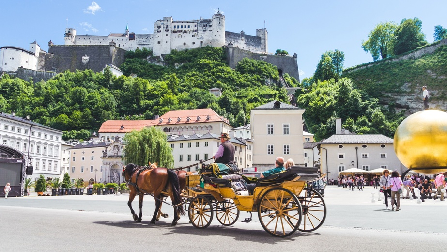 Tourists sightseeing in horse carriage in Salzburg, Austria
